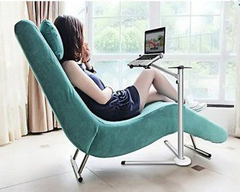 Woman Sitting On Chair Using Handy Stand Laptop