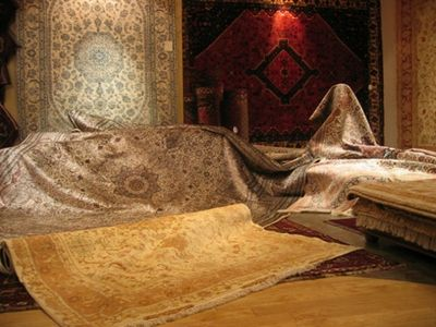 Several Brown Silk And Persian Rugs