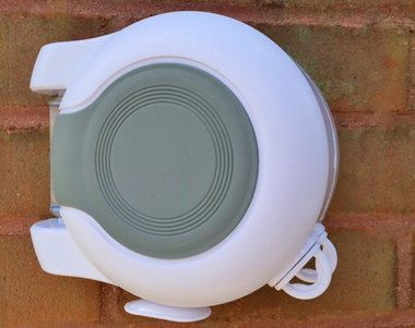 DeLuxe Outdoor Retractable Washing Line On Red Brick Structure