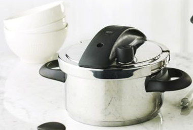 Pressure Cooker With Black Handles