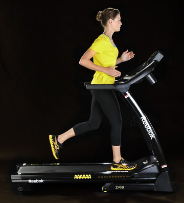 Electric Running Machine With Woman On Deck