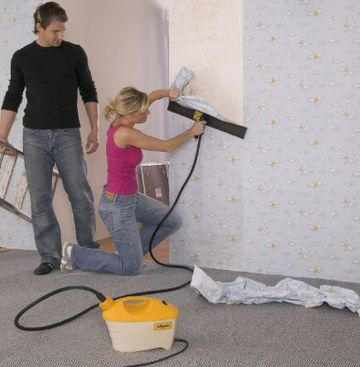 Professional Wallpaper Steamer Used By Woman