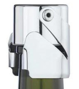 Wine Essentials Chrome Champagne Bottle Stopper On Top Of Green Bottle