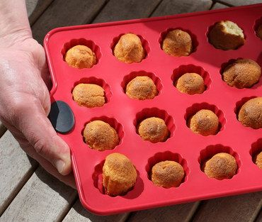 Stackable Silicone Muffin Cups Tray In Man's Hand