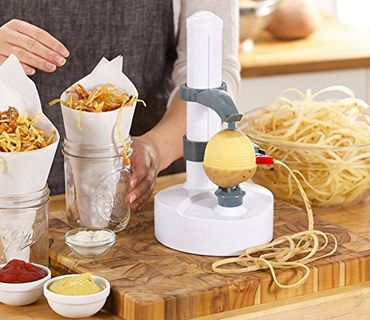 Efficient Electric Power Potato Peeler On Wooden Board