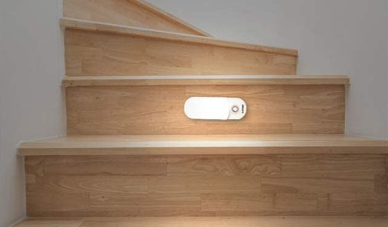 LED Motion Sensor Light On Wooden Stairwell