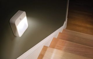 Stick-Anywhere Night Light On Wall In Hall