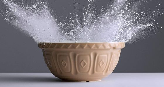 Brown Ceramic Mixing Bowl With Flour