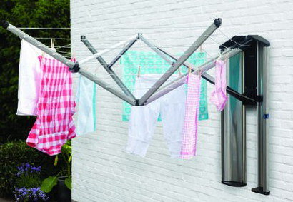 Patio Area Pull Out Washing Line Fixed On White Wall