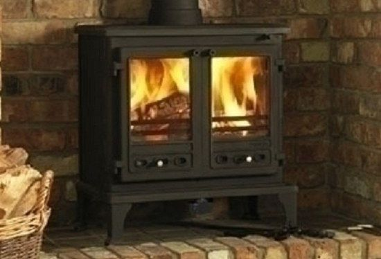 Multi Stove Wood Burning Fireplace On Brick Hearth