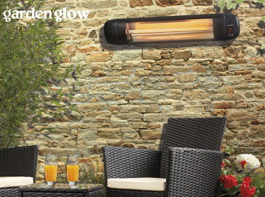 Electric Garden Heater In Black On Brick Wall