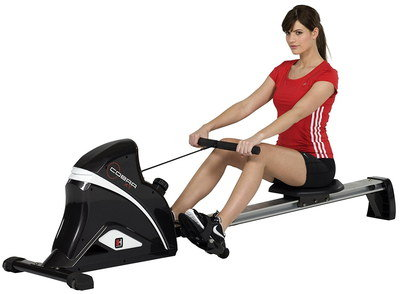 Rowing Machine Used By Girl In Red T-Shirt