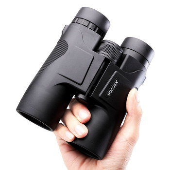 Small Binoculars Bird Watching In Man's Hand