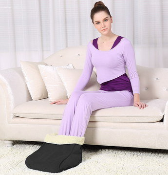 Power Foot Massager Heater Used By Woman On Sofa