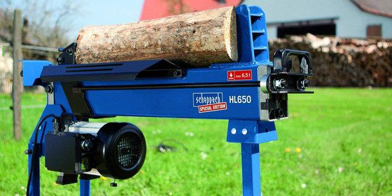 Electric Log Splitter In Blue On Lawn