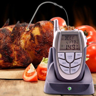 LCD Thermometer With Probe Inserted In Meat Joint