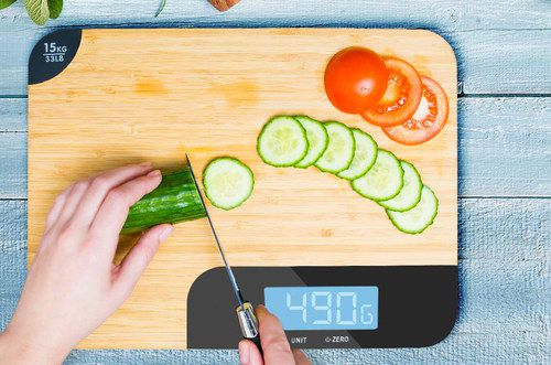 Digital Food Weighing Scale On Wooden Board