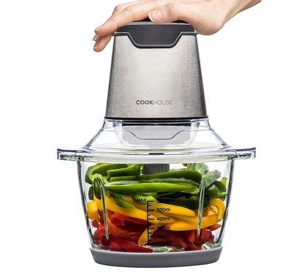 Veg Chopper With Hand On Top Pushing Down