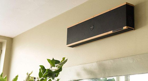 Mounted Soundbar In Black And Gold High On Wall