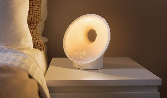 White Wake Up Lamp On Night Stand