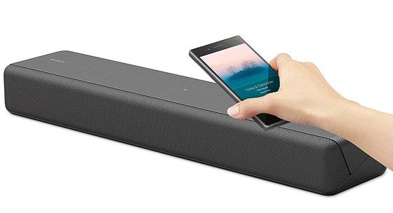 Small Soundbar For TV Showing Smartphone