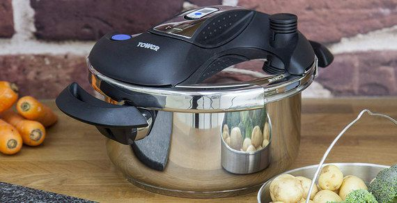 Steel Pressure Cooker With Black Grips