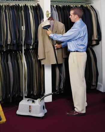 Garment Steamer Being Used By Man On Suit