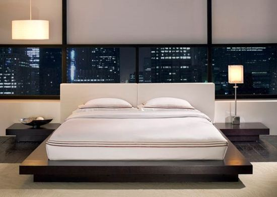 Bedroom With City Backdrop