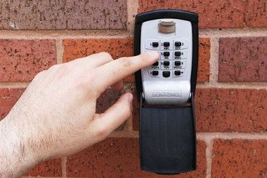 Push Code Key Safe Lock Box On Red Brick Wall