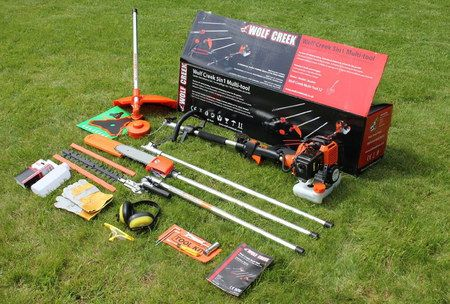 Petrol Strimmer Brush Cutter Laid Out On Grass Lawn