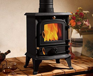 Dense Iron Wood Coal Burning Stove In Tiled Floor